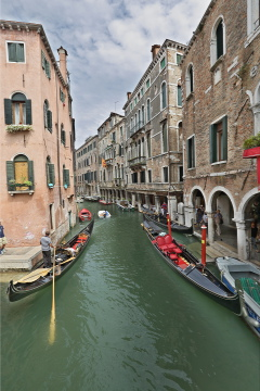 Gondoalas in the narrow canals of Venice